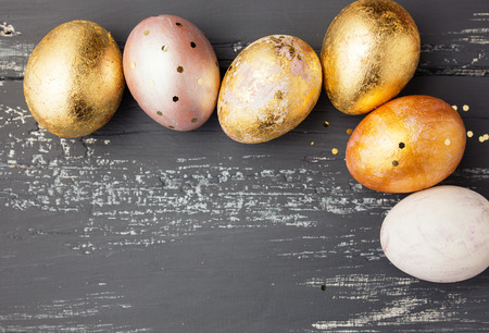 Easter eggs on wooden table. Holiday background photo