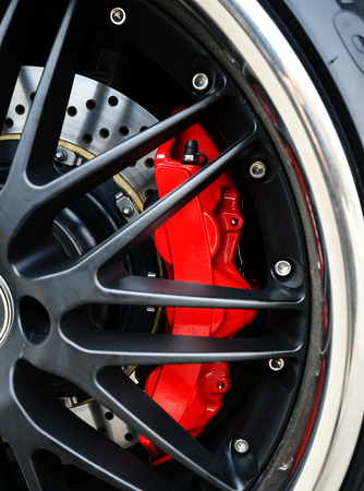 breaks: Brake Disc and Red Calliper, Racing Car wheel close up Stock Photo