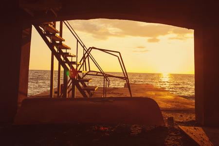 old pier: Old pier at sunset, tinted orange Stock Photo