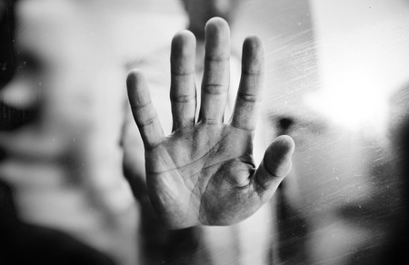 multiple exposure: Man showing stop gesture, black and white photo, multiple exposure effect