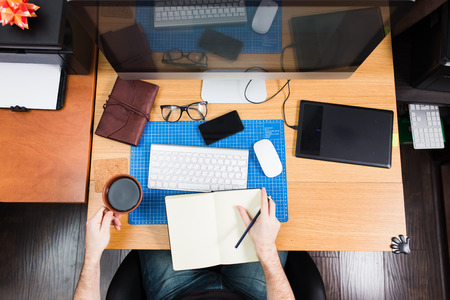 designer chair: Freelance developer and designer working at home, man using desktop computer. Stock Photo