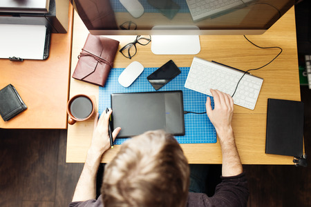 freelance: Freelance developer and designer working at home, man using desktop computer. Stock Photo