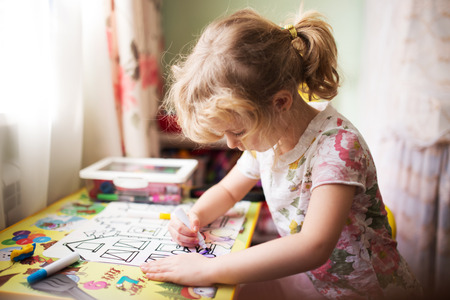home painting: Little girl painting in her room at home Stock Photo