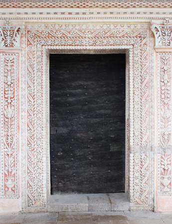 fortify: Ancient door with decorative portal Stock Photo