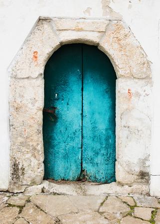 Ancient door with decorative portal photo
