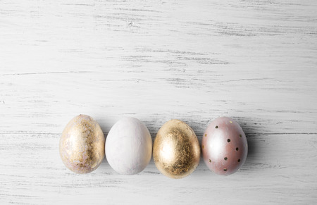 Easter eggs on rustic wooden table. Holiday background. Tinted photo.