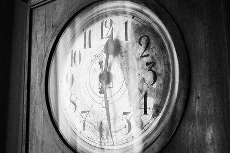 grandfather clock: Antique grandfather clock, black and white photo, close up photo