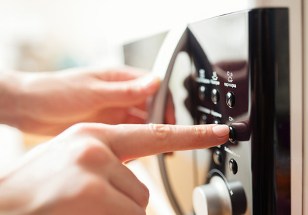 Using microwave oven, close up photo, shallow dof