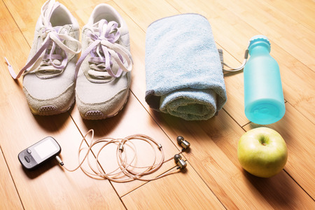 gym clothes: Pair of sport shoes and fitness accessories. Fitness concept Stock Photo