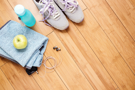 activities: Pair of sport shoes and fitness accessories. Fitness concept Stock Photo