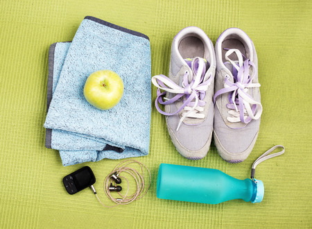 undone: Pair of sport shoes and fitness accessories. Fitness concept Stock Photo