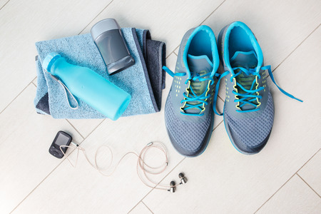 Pair of sport shoes and fitness accessories. Fitness concept Standard-Bild