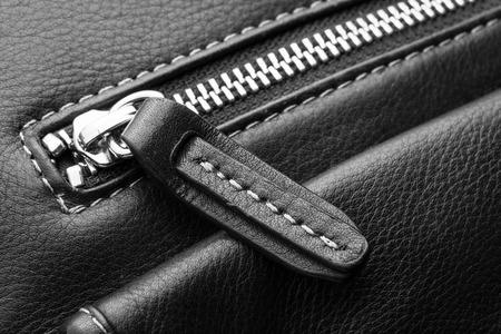Close up of black leather bag zipper, black leather bag close up Foto de archivo