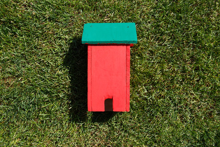 toy house: Toy house on grass close-up Stock Photo