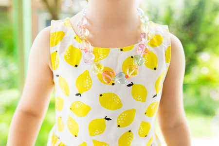 yellow dress: Little girl in yellow dress close up photo