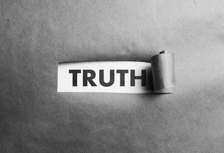 deceit: Torn paper with truth word behind it, black and white photo