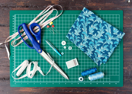 sewing pattern: Patchwork sewing tools on green mat