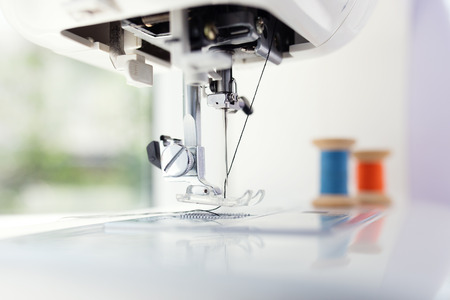 Detail of sewing machine and sewing accessories. Stock Photo