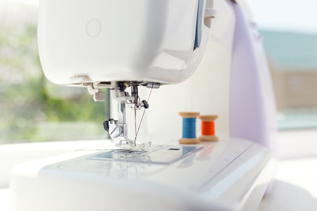 sewing accessories: Detail of sewing machine and sewing accessories. Stock Photo