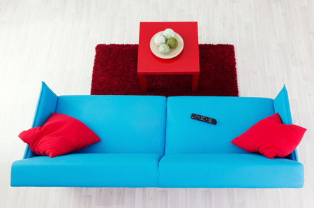 red pillows: Blue sofa with red pillows and red coffee table, top view