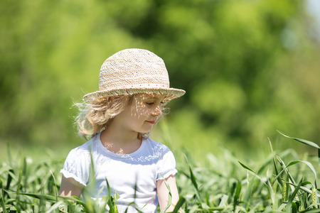 straws: Little girl in field, summer outdoor