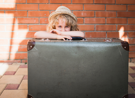 suitcase: Little girl with vintage suitcase. Travel concept