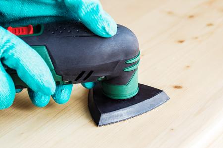 grinder machine: Worker using electric grinder machine Stock Photo