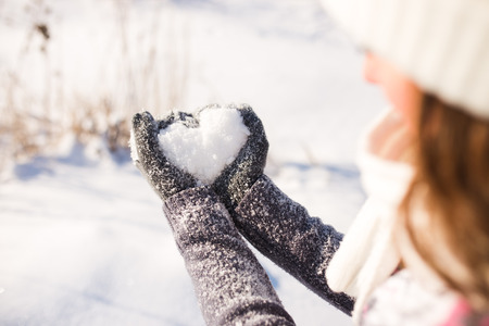 freezed: Ladys glove and snow heart Stock Photo