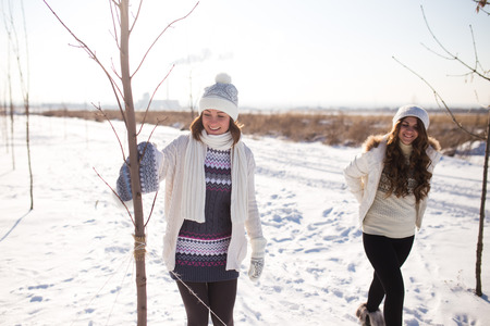 amity: Two young happy woman, two friends, having fun in bright winter day. Lifestyle concept
