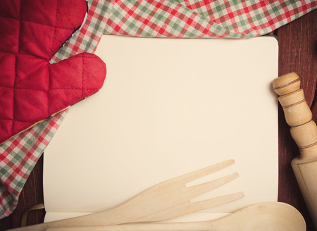 raw food: Blank recipe page with napkin and kitchen tools on wooden table