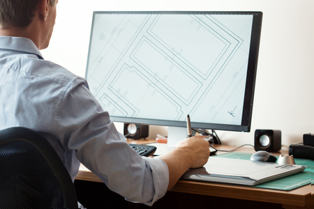 of computer graphics: Graphic designer using digital tablet and computer in office or home