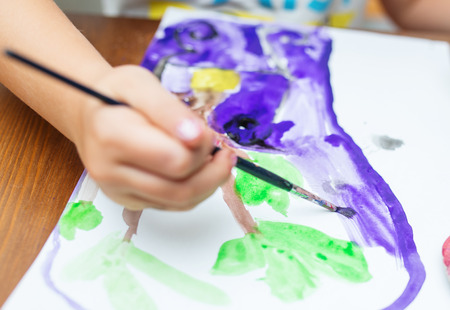 Child Painting at home, close up photo