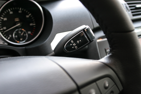 gearstick: Detail on a automatic gear shifter in a new car. Stock Photo