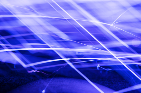 sparklet: Flowing Sparks, photo with a slow shutter speed, blue tinted abstract background
