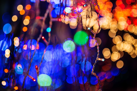 illuminations: Colorful Christmas illumination in city street, close up photo