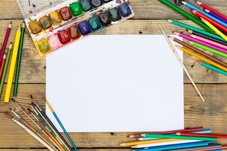 paint palette: Plastic paint palette with paint and brushes on wooden table Stock Photo