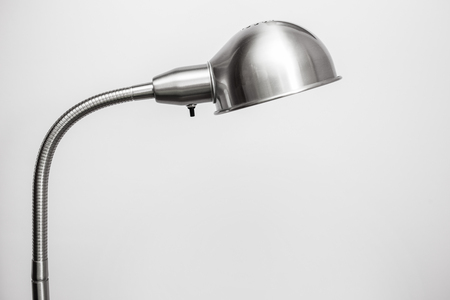 floor lamp: Metal floor lamp standing near wall Stock Photo