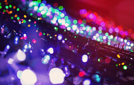 electric avenue: Colorful Christmas illumination in city street, close up photo