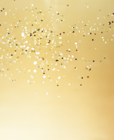 celebrate: Christmas gold background. Golden holiday glowing abstract glitter defocused background
