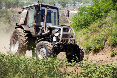 tractive: Farm tractor goes on road Stock Photo