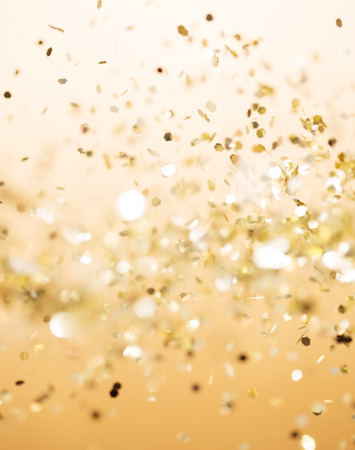 glitter: Christmas gold background. Golden holiday glowing abstract glitter defocused background