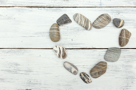 pebbles: A heart shaped pebble stones on a old wood planks