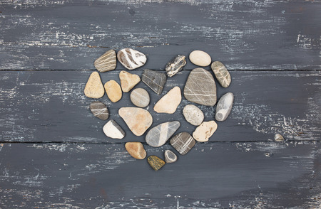 heart of stone: A heart shaped pebble stones on a old wood planks