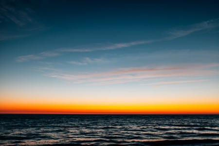 evening glow: Defocused colorful sunset over sea. Summer background. Stock Photo