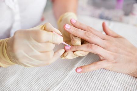 Manicure process in a beauty salon. Close up photo. Stock Photo