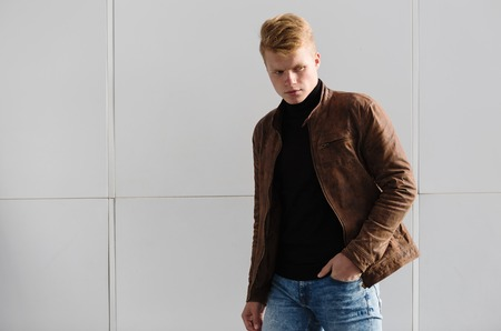 only: Young handsome stylish man in brown jacket in autumn time outdoor in casual style. Stock Photo
