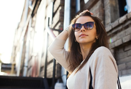 white hat: Young pretty woman outdoor fashion portrait. Beautiful girl casual dress and sunglasses.