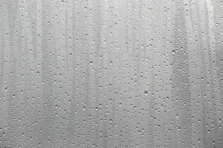 Closeup water condensation on window glass background.