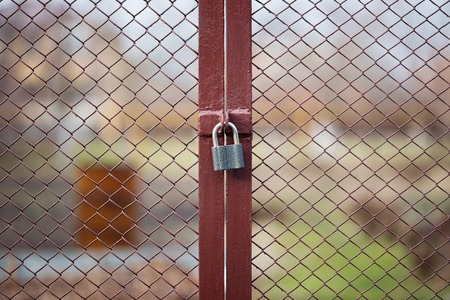 locked: Locked wire mesh fence on private land