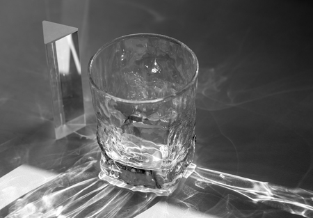 Beautiful caustic effect as light passes through a glass Stock Photo